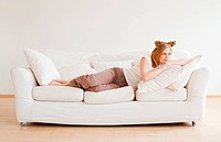 cute young woman with neko ears dreaming on couch