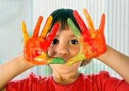 Schoolgirl hands painted in colorful paints