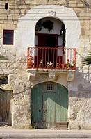 Marsaxlokk, Malta  1806 Doorway, Balcony, Flowers facing the harbor
