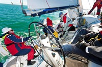 Offshore yacht racing crew working together