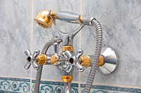 Modern stainless steel tap at bathroom