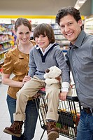 Portrait of family with son 6-7 shopping (thumbnail)