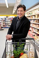Portrait of man shopping in supermarket
