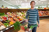 Man shopping in supermarket