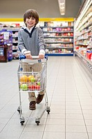 Boy 6_70 shopping in supermarket