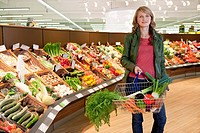 Woman shopping in vegetable department
