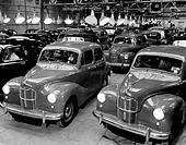 Car production after the Second World War, Marshall Plan. Array of Austin A40 cars that have been produced at a car factory in the UK in 1949. The raw...
