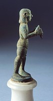 Bronze statue depicting armed figure making offering, side view, Etruscan Civilization, 625-600 BC.  Arezzo, Museo Archeologico Statale Nazionale 'Gai...