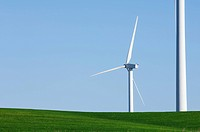 windmills in an idyllic green meadow and clear sky