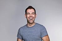Studio portrait of mid adult man laughing
