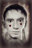 young man with white makeup and red hearts on face