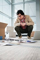 Young businessman unpacking office (thumbnail)