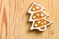 photo shot of christmas gingerbread on wooden background