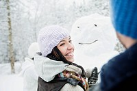 Friends creating a snowman (thumbnail)