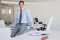 Young smiling businessman in office (thumbnail)