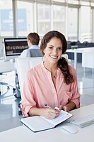 Portrait of smiling businesswoman in office (thumbnail)