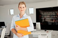 Portrait of smiling business woman holding files