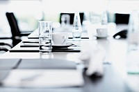 Close up of place setting on table in board room