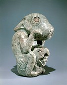 Jade rabbit statue with a warrior head with a helmet in the form of an eagle between its legs. Artefact from Mexico. Aztec Civilization, 15th Century....