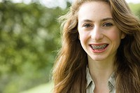 Teen Girl with Braces Smiling Directly to the Camera