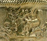 A decorative detail from a ritual object with scenes of fighting between animals. Detail. Goldsmith art. Scythian Civilization, 5th Century BC.  Kiev,...