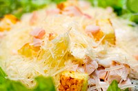 caesar salad from cut smoked bacon with grated cheese and croutons, macro