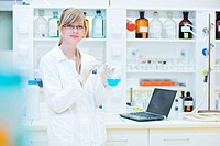 portrait of a female researcher carrying out research in a chemistry lab color toned image, shallow DOF