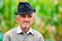 Portrait of an old farmer with hat outdoors