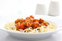spaghetti with tomato sauce in white background