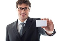 Businessman with blank businesscard, focus on foreground. Copy space for your own text.