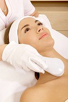 Laser hair removal in professional studio. Beautiful brunette woman.