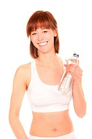 Beautiful athletic woman with bottle of mineral water, isolated on white