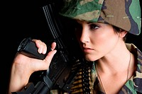 Beautiful military woman holding gun