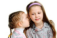 An image of a girl telling a secret to her sister