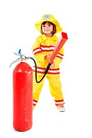 Young child as firefighter holding a fire extinguisher