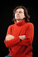 Man in red sweater and glasses.