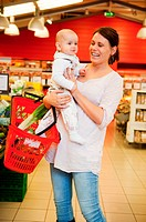 A mother with baby daughter in a grocery store
