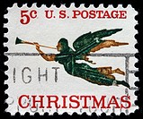 UNITED STATES OF AMERICA _ CIRCA 1970s: A greeting Christmas stamp printed in the USA shows angel with horn, circa 1970s