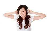 Attractive woman listen music with headphone, closeup portrait on white background.
