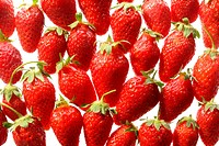 Pattern of red ripe strawberries on white background