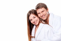 Young attractive couple in dressing gowns on white background
