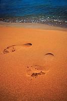 foot trace on desert sand