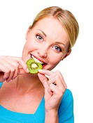 Closeup face of the young cheerful woman eats slice of the fresh kiwi _ on white