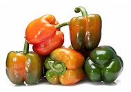 Red and green peppers isolated over a white background.