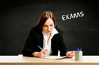 photo of student sitting at desk having her exams