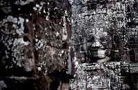 Carved faces of Budha at the famous Bayon temple in Angkor region of Siem Riep in Cambodia.
