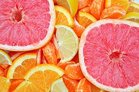 Background closeup of bright Orange, Lemon, and Grapefruit Slices