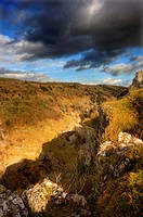 Beautiful natural landscape over limestone cliffs with bright colors and dramatic sky