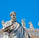 St Peter statue in St. Peter Square Rome, Italy with blue sky background
