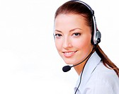 Beautiful young smiling woman in headset. Stuido shot on a white background